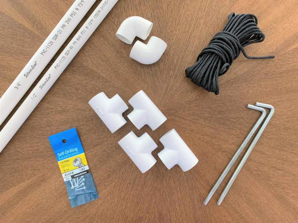 Materials for building a DIY solar panel mount laid out on a wooden table