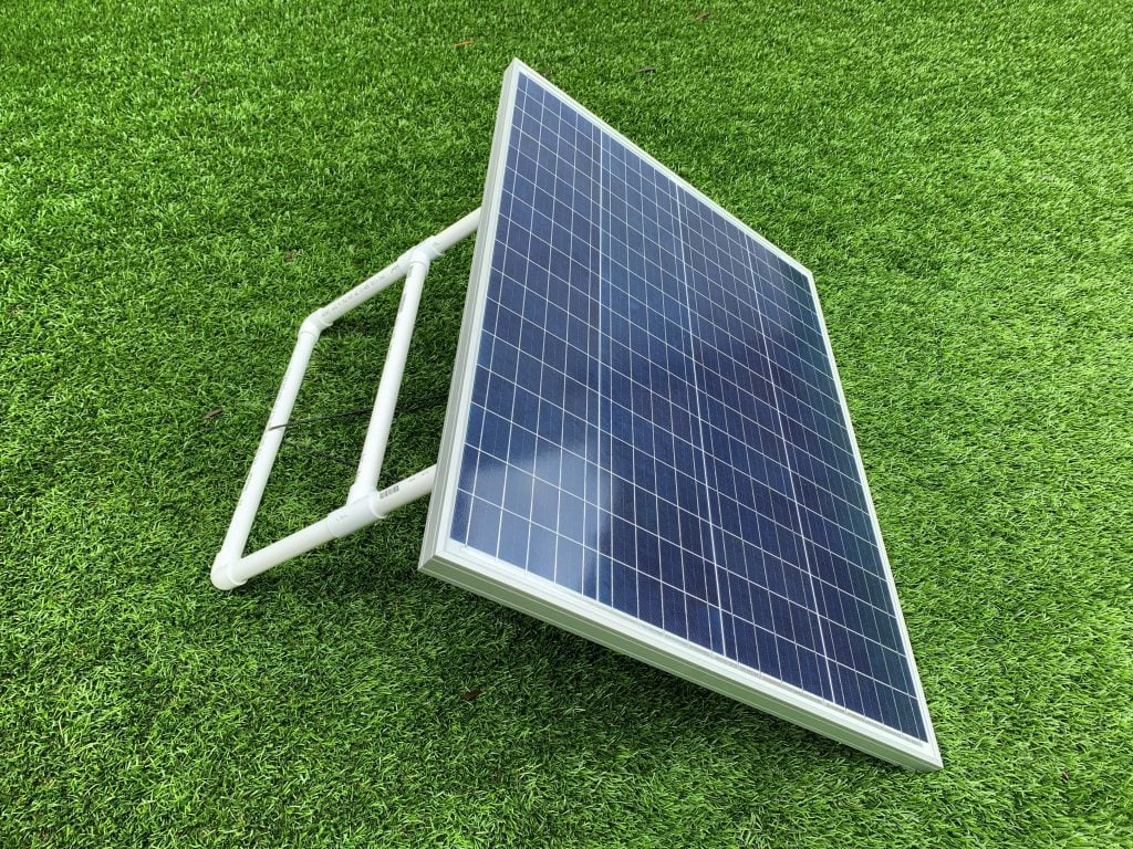 A solar panel mounted with a DIY solar panel rack made of PVC pipe