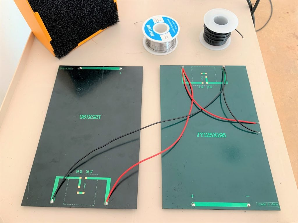 Two portable solar panels wired in parallel