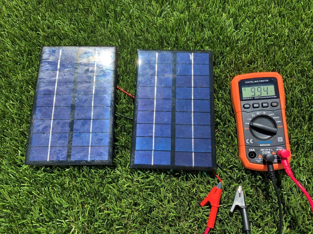 Testing the voltage of two solar panels wired in parallel with a digital multimeter