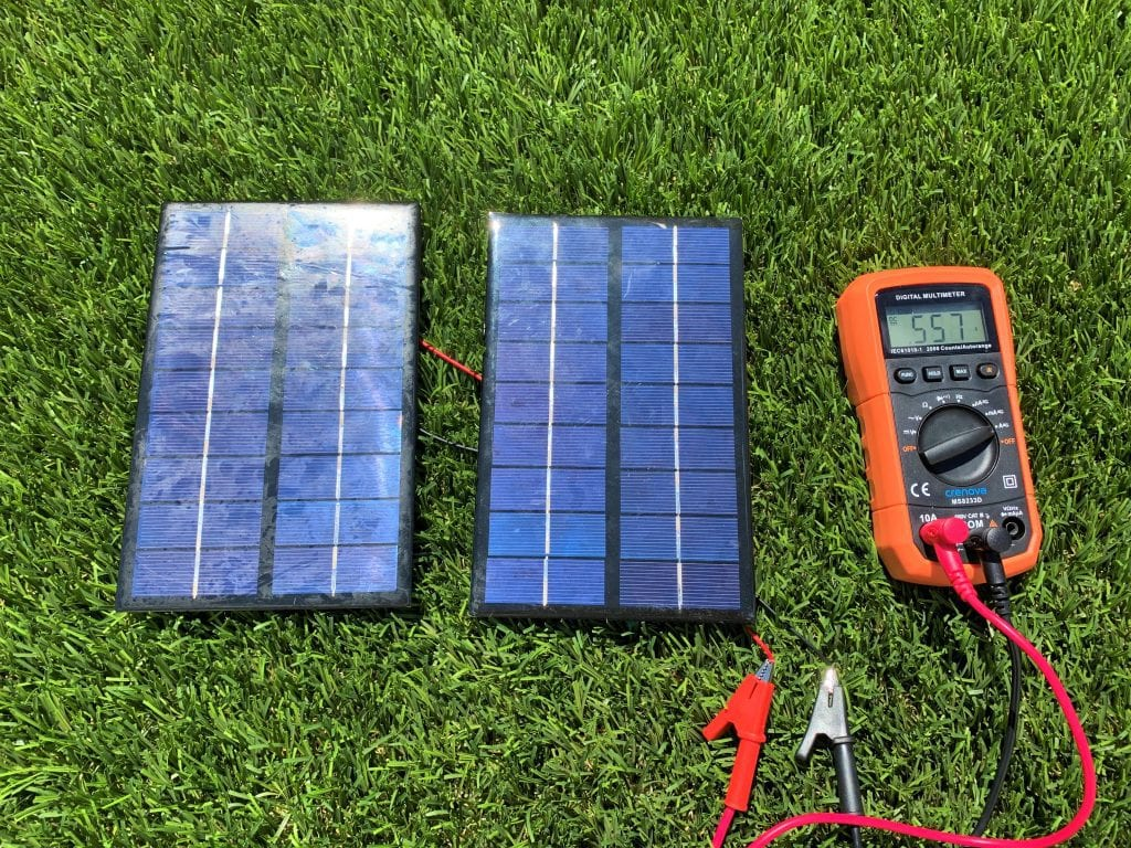 Testing the amperage of two solar panels wired in parallel with a digital multimeter