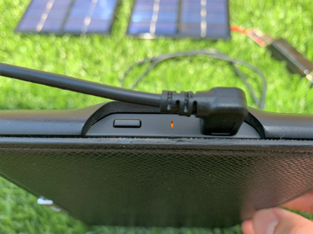 A solar charger charging a Kindle