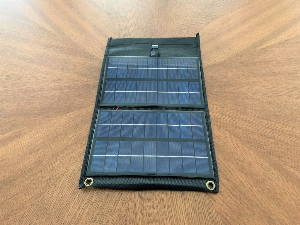 A DIY solar phone charger with two eyelets at the bottom