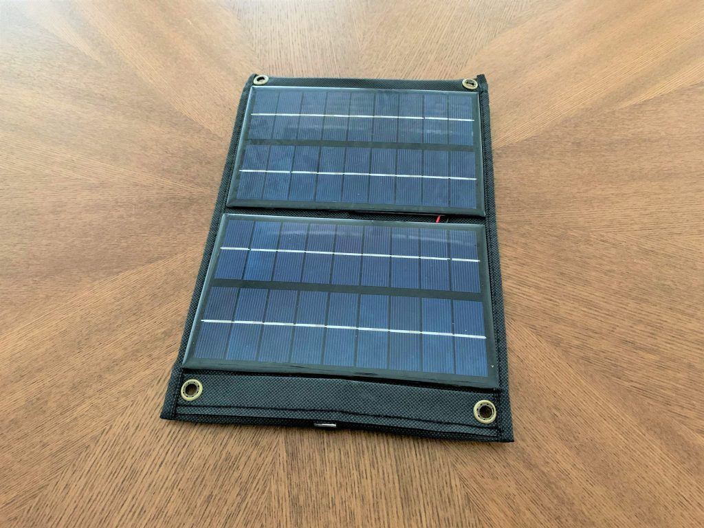 A completed DIY solar USB charger resting on a table